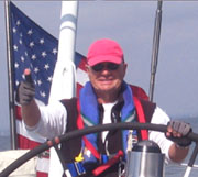 Skipper Walker at the Helm of the Grey Goose